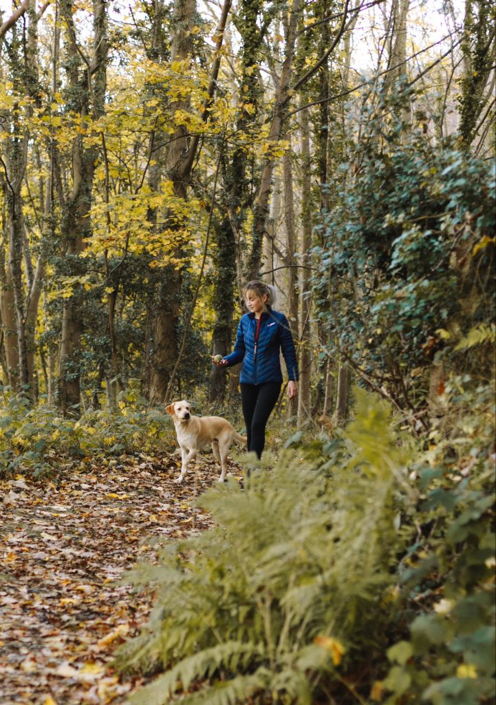 Woman walking in remote place to avoid dealing with fearful aggression in dogs